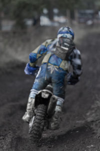 Dirt spraying motorcross bike
